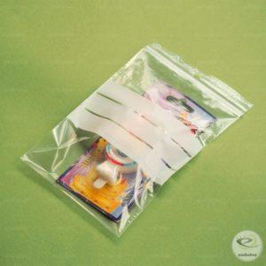 Sachet zip à bandes blanches 12 x 18 cm